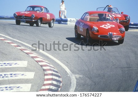 Vintage racecars speed along the track during the Laguna Seca race in California