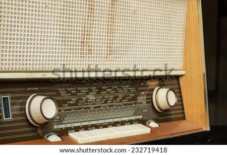 Vintage radio isolated on a black background - stock photo