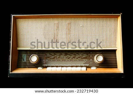 Vintage radio isolated on a black background - stock photo