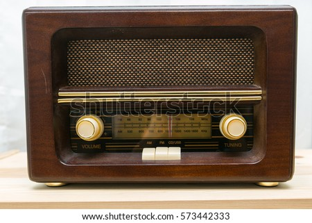 Vintage Radio Receiver from the 50s placed on wooden table. White background
