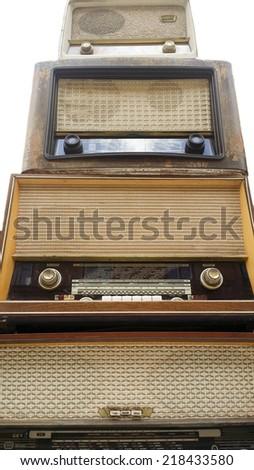 Vintage radio tuner receivers, against white - stock photo