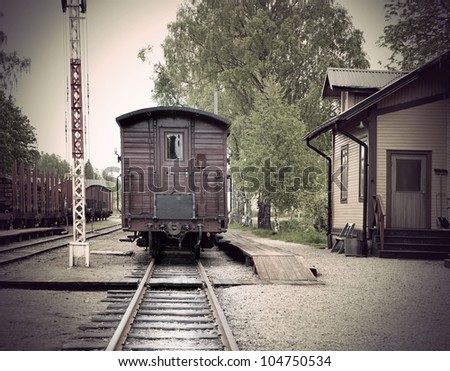 Vintage railway station with wooden car in small town - stock photo