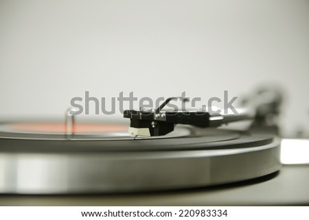 Vintage record player shot with wide aperture and focus on cartridge - stock photo