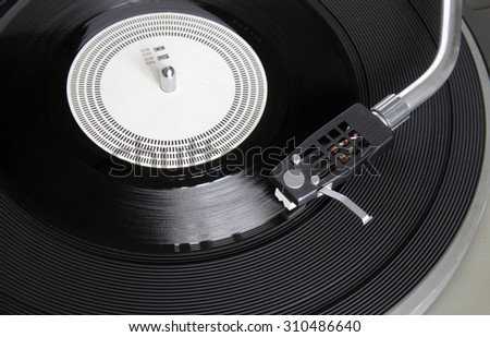 Vintage record player with phonorecord - stock photo