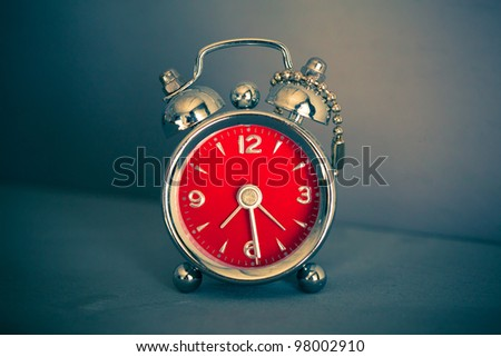 vintage red alarm clock - stock photo