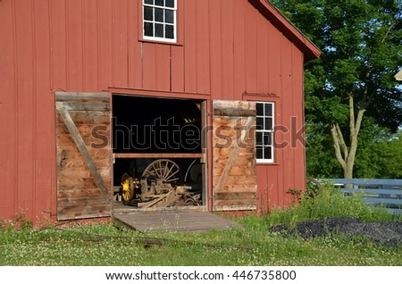 Vintage red barn with open doors - stock photo