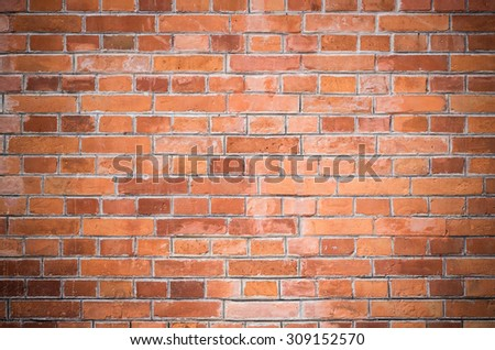 Vintage red brick wall with vignetting
