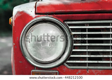 Vintage red car headlight - stock photo