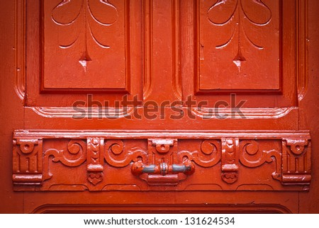 Vintage red door with chipped paint