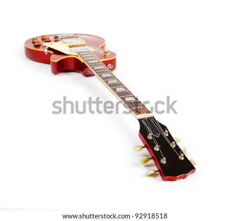 Vintage red electric solid body guitar,Isolated on white. Focus is on nut (0 fret) - stock photo