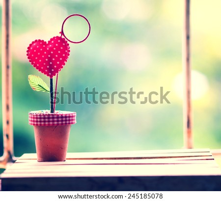 vintage red heart on nature background, Valentine concept - stock photo