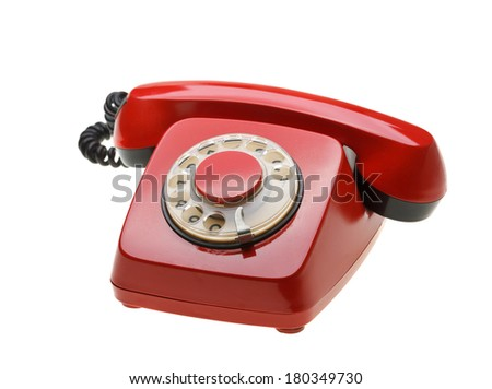 Vintage red phone isolated on a white background. Concept for hot-line.