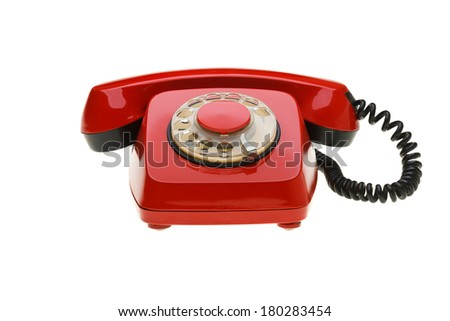 Vintage red phone isolated on a white background. Concept for war  hot-line. - stock photo