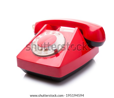 Vintage red telephone isolated over white background - stock photo