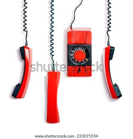 Vintage red telephone. Wall phone and three receivers collection on white background. Communication technology - stock photo