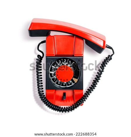 Vintage red telephone. Wall phone isolated on white background. Communication technology. Object with clipping path - stock photo