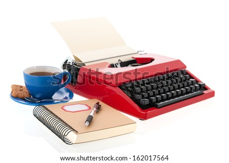 Vintage red typewriter with blank paper isolated over white background - stock photo