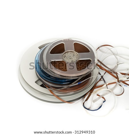 Vintage Reels to Reel Tape Bobbin For Sound Recording on white background. Selective focus. - stock photo