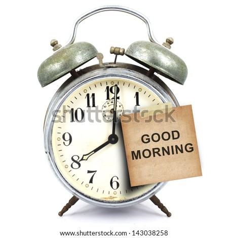vintage retro alarm clock and text good morning  on the old paper short note isolated white background - stock photo
