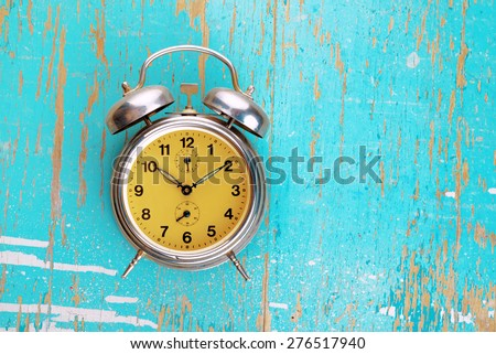 Vintage Retro Alarm Clock on Grunge Rustic Blue Background, Time Concept - stock photo