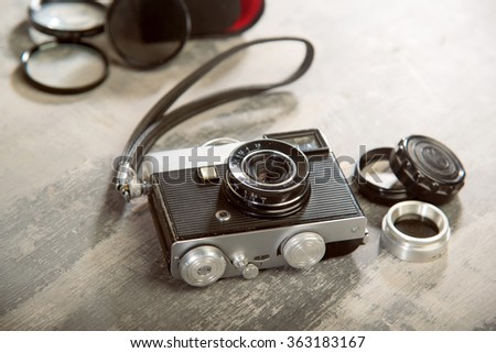 vintage retro camera with photo filters on a wooden texture