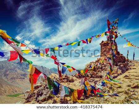 Vintage retro effect filtered hipster style image of Buddhist prayer flags (lungta) in Spiti Valley, Himachal Pradesh, India - stock photo