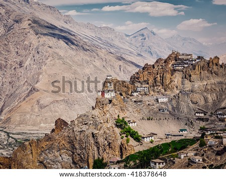 Vintage retro effect filtered hipster style image of Dhankar gompa Buddhist monastery on cliff and Dhankar village in Himalayas, Dhankar, Spiti valley, Himachal Pradesh, India - stock photo