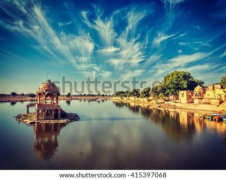 Vintage retro effect filtered hipster style image of Indian landmark Gadi Sagar - artificial lake. Jaisalmer, Rajasthan, India - stock photo