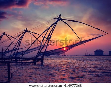 Vintage retro effect filtered hipster style image of Kochi chinese fishnets on sunset. Fort Kochin, Kochi, Kerala, India - stock photo