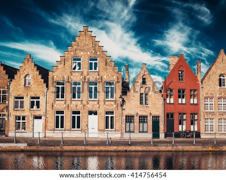Vintage retro effect filtered hipster style image of old houses and canal in Bruges (Brugge) on sunset, Belgium - stock photo
