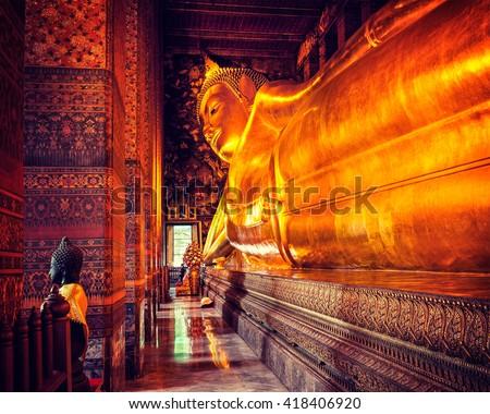 Vintage retro effect filtered hipster style image of reclining Buddha gold statue. Wat Pho, Bangkok, Thailand - stock photo