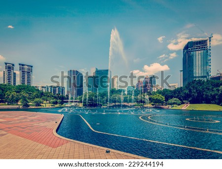 Vintage retro effect filtered hipster style image of  skyline of Central Business District of Kuala Lumpur, Malaysia - stock photo