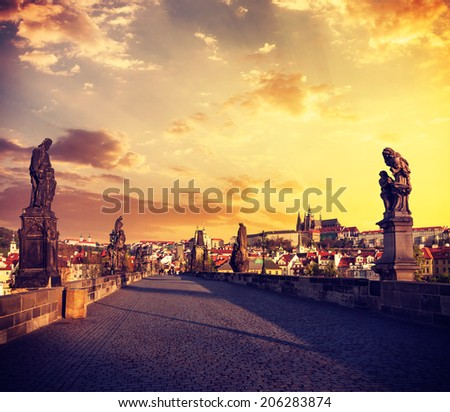 Vintage retro effect filtered hipster style travel image of Charles bridge and Prague castle in the early morning on surise. Prague, Czech Republic - stock photo