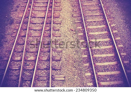Vintage retro filtered picture of railway tracks.  - stock photo