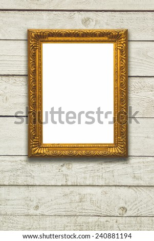Vintage retro golden picture on wooden white planked wall. - stock photo