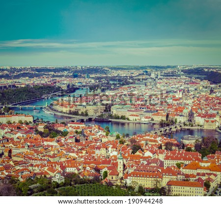 Vintage retro hipster style travel image of aerial view of Charles Bridge over Vltava river and Old city from Petrin hill Observation Tower. Prague, Czech Republic - stock photo