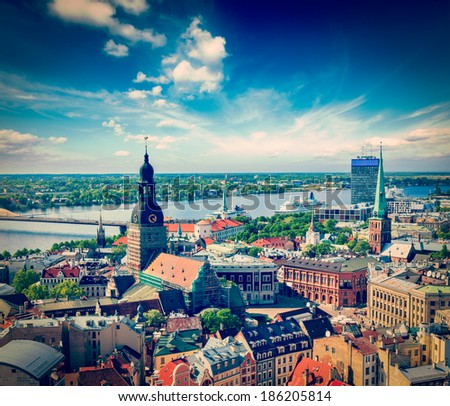 Vintage retro hipster style travel image of aerial view of Riga center from St. Peter's Church, Riga, Latvia - stock photo