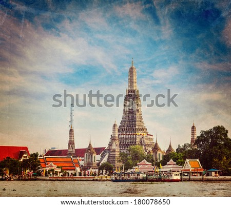 Vintage retro hipster style travel image of Buddhist temple (wat) Wat Arun on Chao Phraya River with grunge texture overlaid. Bangkok, Thailand - stock photo