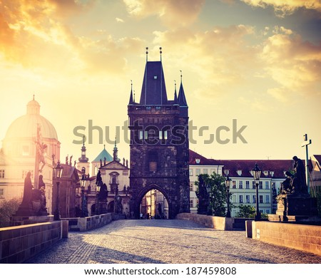 Vintage retro hipster style travel image of Charles bridge tower in Prague on sunrise, Czech Republic - stock photo