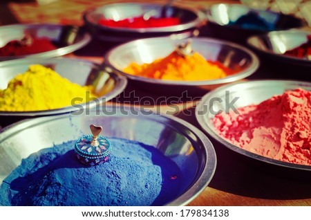 Vintage retro hipster style travel image of India symbol - Colored colorful powder kumkum in bowls on Indian bazaar for Holi and other festivals celebration - stock photo