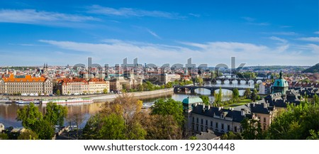 Vintage retro hipster style travel image of panoramic view of bridges over Vltava river from Letna Park. Prague, Czech Republic. Stitched panorama - stock photo