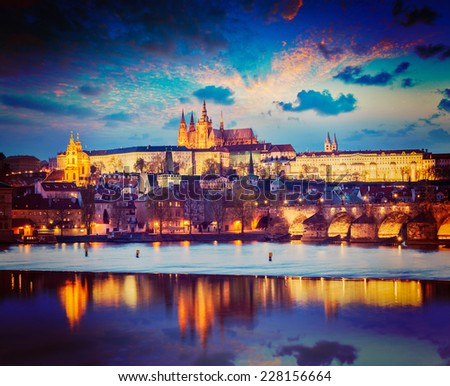 Vintage retro hipster style travel image of Prague Europe concept background - view of Charles Bridge and Prague Castle in twilight. Prague, Czech Republic - stock photo