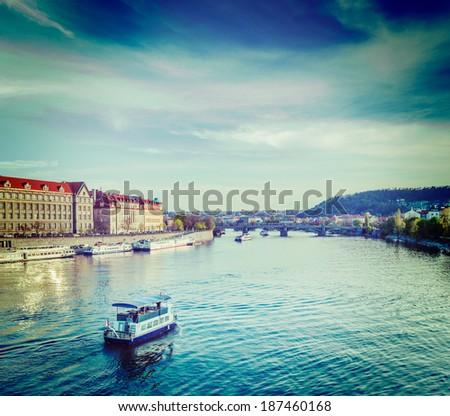 Vintage retro hipster style travel image of tourist boat on Vltava river in Prague, Czech Republic - stock photo