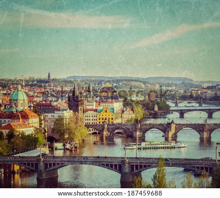 Vintage retro hipster style travel image of travel Prague concept background - elevated view of bridges over Vltava river from Letna Park with grunge texture overlaid. Prague, Czech Republic - stock photo