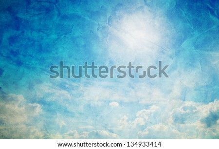 Vintage, retro image of sunny blue sky with puffy clouds. Grunge and creased canvas texture - stock photo