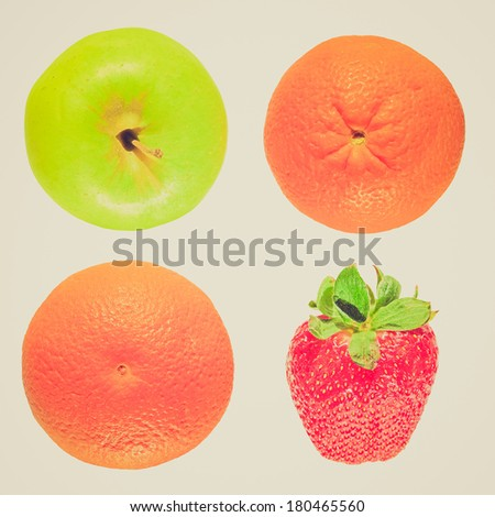Vintage retro looking Apple orange and strawberry fruit - isolated over white background - stock photo