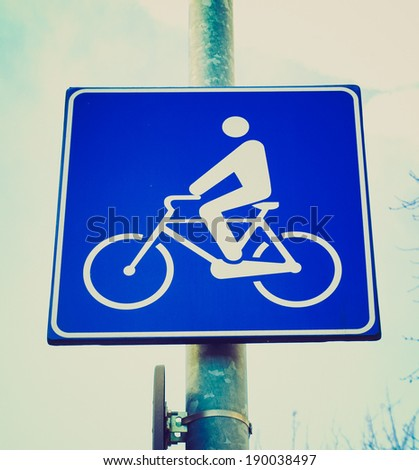Vintage retro looking Bike lane traffic sign over blue sky