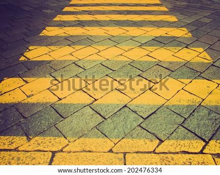 Vintage retro looking Detail of zebra crossing (pedestrian traffic sign) - stock photo
