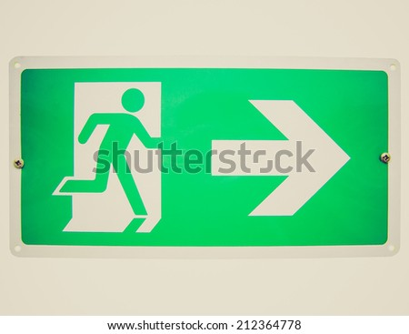 Vintage retro looking Fire exit sign isolated over white background - stock photo