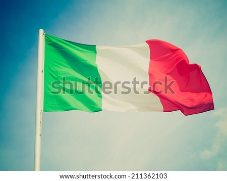 Vintage retro looking Flag of Italy over a blue sky